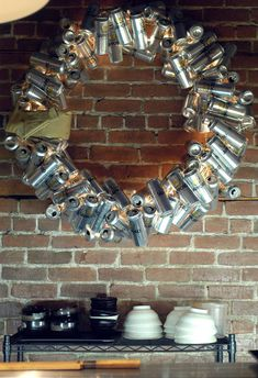 "Take a little inspiration from interior designer Chad Falkenberg who has just finished ""decking the halls"" of a number of Vancouver shops and restaurants for the season. A wreath made from 100 beer cans, an upside down Christmas tree made from ribbon wrapped kraft paper boxes and a twinkle arch made of live plum trees."