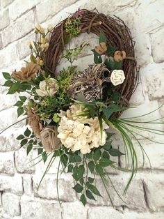 Burlap Wreath / Summer Wreath / Front Door Wreath / Grapevine Wreath / Floral Wreath / Etsy - Looking for the perfect focal point to spruce up your front door or entryway? This neutral burlap wreath wont disappoint! It was handmade using a grapevine wreath base adorned with a beautiful arrangement of neutral burlap flowers, a zebra print silk flower, a cream hydrangea silk flower, moss, and artificial greenery. This wreath would also be gorgeous displayed as an accent...