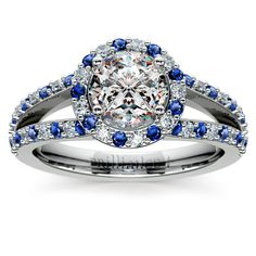Halo Split Shank Alternating Diamond & Sapphire Engagement Ring in Platinum Twenty nine round cut diamonds and twenty nine round cut sapphire gemstones are alternately set in this platinum diamond and gemstone engagement ring setting, accenting your choice of center diamond. Proudly made in the USA.