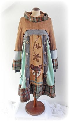 CoRdeLiA Snood Hooded Smock Dress Recycled Upcycled - Eco Friendly - Wearable Art - Appliqué Clothing A whimsical handmade smock jumper dress with a snood hood. This dress is created with a unique fabric art Folk Fox design, (the top section of this dress is lightweight) This has wooden buttons for decoration. Main Colours ~ Brown, Green, Beige, Grey, Charcoal, Rust. This jumper dress is eco friendly and has been made from Recycling Upcycling preloved knitwear including Cashmere, checked...