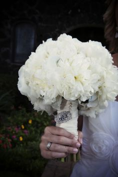 bridesmaid bouquet- All white!!!! Even white ribbon with the jewels on the handle.