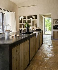 .concrete top/natural rustic wood cabinets/rustic floor