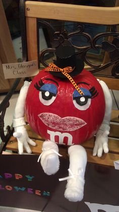 My daughter's class had to decorate a pumpkin as a red M & M and this was our creation!