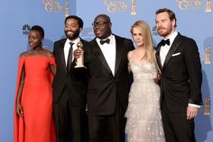 Lupita Nyong'o and Chiwetel Ejiofor, director Steve McQueen, actors Sarah Paulson and Michael Fassbender, winners of Best Motion Picture - Drama for Years a Slave,' pose in the press room during the Annual Golden Globe Awards