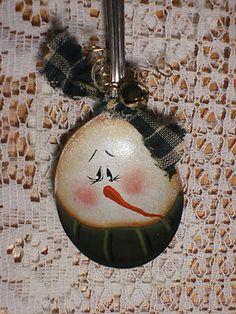 Vintage silver spoon snowman ornament.