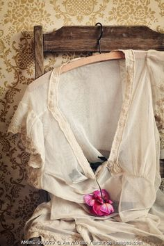 www.arcangel.com - a-vintage-nightgown-hanging-on-a-chair-wth-a-rose