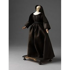 Ursuline Nun    Object:  Ecclesiastical figure    Place of origin:  France (possibly, made)   germany (possibly, made)   Netherlands (possibly, made)    Date:  18th century (made)    Artist/Maker:  Unknown (production)    Materials and Techniques:  Figure made of tow and wax, dressed in linen and woollen materials    Credit Line:  Given by Mr. G. Smith    Museum number:  1212:1-1905    Gallery location:  In Storage