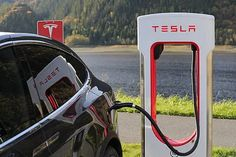 Tesla electric cars have become one of the best electric automobiles in the world. How long does it take to charge a Tesla? Bmw I3, Buy A Tesla, Volkswagen, Tesla Inc, E Mobility, Elon Musk, Self Driving, Bitcoin Price, Electric Cars