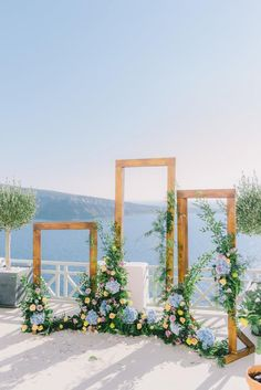 small wedding Santorini Greece Wedding - A small and intimate wedding in Oia Ideas for wedding decoration Wedding arch decoration Inspiration for wedding deco Santorini wedding Indoor Wedding Ceremonies, Wedding Ceremony Arch, Indoor Ceremony, Wedding Scene, Wedding Ceremony Decorations, Wedding Frames, Decor Wedding, Wedding Centerpieces, Wedding Table