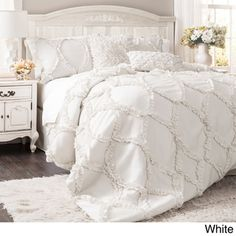 @Overstock - Lush Decor Avon 3-piece Comforter Set - This light and airy Avon comforter set comes with a comforter and two matching pillow shams, all featuring ruffle ribbon embroidery for an elegant feel. This comforter set comes in white and ivory to match any style of bedroom decor.  http://www.overstock.com/Bedding-Bath/Lush-Decor-Avon-3-piece-Comforter-Set/9173198/product.html?CID=214117 $154.99