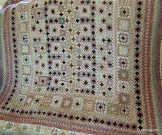 This crochet blanket is beautiful with the different sized blocks and color contrasts making it special.
