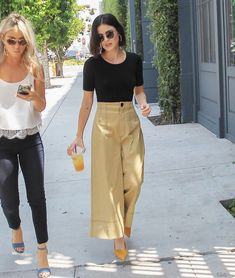 Lucy Hale's Wide Leg Crop Pants and Yellow Heels Look for Less -You can find Lucy hale and more on our website.Lucy Hale's Wide Leg Crop Pants and Yellow Heels Look for L. Wide Pants Outfit, Summer Pants Outfits, Gaucho Pants Outfit, Culottes Outfit Summer, Yellow Pants Outfit, Dress Pants, Plazzo Pants Outfit, Culotte Pants, Mode Outfits