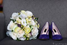 A gorgeous bridal bouquet featuring light peach, yellow and lavender roses with touches of hypericum for Katie and Dan's Tyler Arboretum wedding - by Buttercup: Asya Photography.