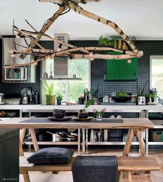 DIY : Turn branches (and a string of lights) into a chandelier - Photo: Per Magnus Persson for Elle Decoration S.A. (Home of Swedish stylist of Jimmy Schönning)