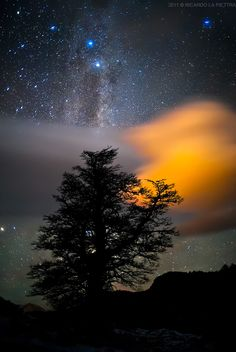Milky way and enlightened cloud.  Los Glaciares National Park.  Patagonia, Argentina.  by Ricardo La Piettra.