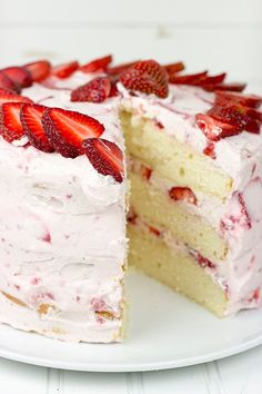 Fresh Strawberry Cake - This cake features loads of fresh strawberries and a light whipped cream topping. It's PERFECT for summer!!