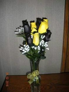 Waxed dipped yellow and black roses.