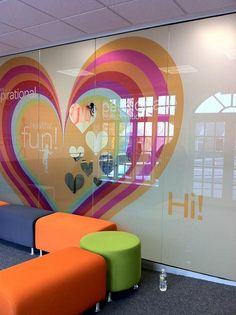 A branded graphic cling adorns the new, full height glass wall separating the dance studio from the waiting area, in this Martinsville space.