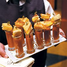 Tomato-soup shooters with miniature grilled cheese sandwiches make a fun and filling passed hors d'oeuvre.