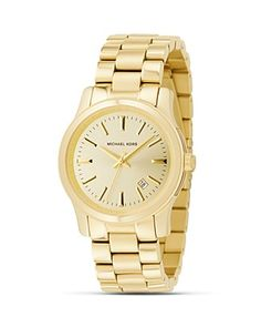 Michael Kors gold watch...this one exactly is tough to find! No numbers, just lines. Want want want. Bloomingdales.