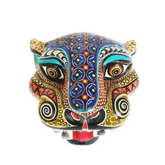 Beautiful jaguar mask by Manuel Cruz. Manuel Cruz is a talented woodcarver from Oaxaca. He has developed a style of his own, creating wonderful figures very nicely painted. The feline mask is so very nicely painted!
