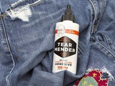 Tear Mender  - Fabric Adhesive Tear Mender is a natural and non-toxic liquid adhesive that bonds fabric upon contact. You can apply it like glue on a tear, or spread it on a fabric patch, and it bonds in minutes. Repaired fabrics stay flexible and soft even after washing. Great for dropped hem, a broken belt loop, or a run in the carpet. It also works on tears in the seat of your car, damaged sports gear, or rips in a tent. It's waterproof and UV-resistant.