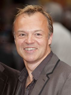 Graham Norton.  Witty, self-deprecating, playful, fabulous giggle, and completely adorable.  An Irish imp!