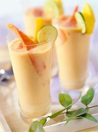 Papaya-Mango Ice Cream Daiquiri  Part cocktail, part dessert, this mango nectar and rum-based drink with fresh papayas, honey and ice cream will satisfy your sweet tooth and get the party going. Edited to say: use ice in the blender as well, as it is very sweet!