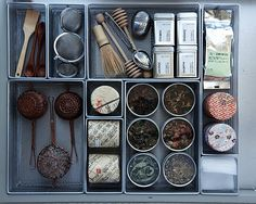 I have to do this...loose boxes of teas in the pantry, cans of tea in another cupboard, tea balls in a drawer and another infuser in yet another cupboard...LOVE this...