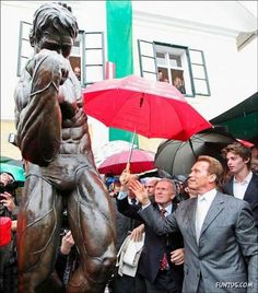 Governor Arnold Schwarzenegger admires himself at the opening of the Schwarzenegger Museum.