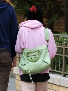 31296da9a78 Mary-Kate and her mint green Balenciaga bag, pictured here from 2004 (when