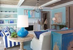 Living Room. Coastal Home Living Room. Coastal Home Living Room Decorating Ideas. Vibrant ocean colors bring a seaside feeling to this coastal living room. #Livingroom #Coastal #Interiors Letitia Little.