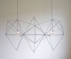 Prism Light by Nathalie Dewez    beautifully simplistic geometric wire lights.  great concept for the modern chandalier