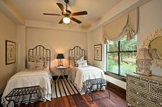 Black & white never looked so good - love the black trim paint around windows and the chest is breathless - - Santa Barbara Style in Austin - traditional - bedroom - austin - Jenkins Custom Homes