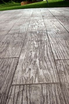 BASEMENT FLOORING IDEA - stamped concrete to look like wood or stone. definitely an option for a patio. Love this idea; great for basement, could stain dark brown for better wood effect!
