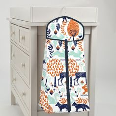 Diaper Storage in Navy and Orange Woodland by Carousel Designs. Changing your baby takes both hands, so keeping diapers nearby is a must. Provide this essential convenience while enhancing the decor of your baby's nursery.