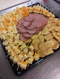 Love the cheese stackers.Now that's a cheese, cracker, and sausage tray for ya...