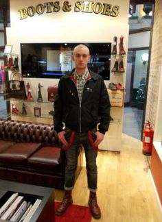 skinhead in Harrington jacket and Doc Marten boots