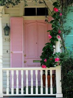 Pink mandevilla flowers and turquoise shutters - oh so deliciously Key West.