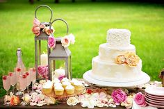 Rose petals scattered across this dessert table add to the country garden feel
