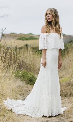 """Part of our 'We Are All Just Lovers' Collection The """"Winnie"""" was inspired by the designers' mother's wedding dress. This off the shoulder bohemian wedding gown made with a floral cotton polyester blend lace and fully lined with a matte stretch satin. Armbands are designed with an elastic band for comfortable wear also leaving …"""