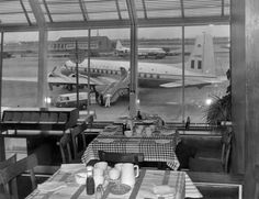 Airside, restaurant seating area overlooking apron, 1950s.