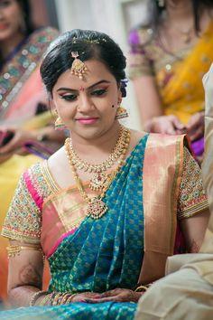 South Indian bride. Gold Indian bridal jewelry.Temple jewelry. Jhumkis. Blue silk kanchipuram sari with contrast embroidered pink blouse.Braid with fresh jasmine flowers. Tamil bride. Telugu bride. Kannada bride. Hindu bride. Malayalee bride.Kerala bride.South Indian wedding.  20 Repins   6 Likes