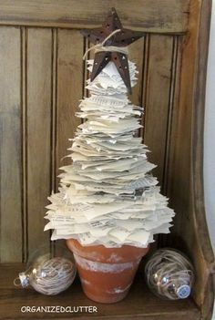17 Christmas decorations for the home, including plenty of unique Christmas crafts like this tree made from individual book pages.