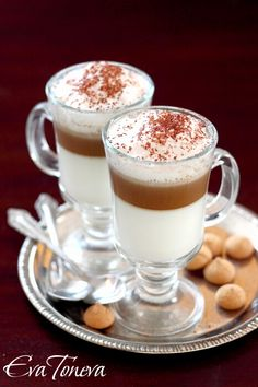 Latte_Macchiato  Ingredients for 2 servings:  400 ml milk   100 ml strong espresso   cocoa for sprinkling Preparation: Heat the milk to boiling. Beat it with a mixer to form a solid foam. Divide it into two cups of heated volume of 300 ml. espresso ready in two cups.