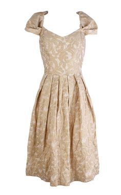 I love how this dress is so old fashioned, but somehow its still modern. Its too different time frames put into one dress. It's very pretty and the patterns are interesting.