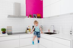 love the pop of color in an all white kitchen - kitchen interior by jeg er jonathan