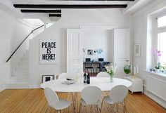 """A white breakfast room in a Swedish apartment for sale. """"Peace is Here!"""""""