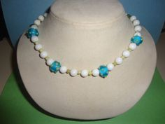 Designed to enhance the four white core focal beads from the African trade bead era. A stunning STATEMENT PIECE in white and blue. Stunning - pinned by pin4etsy.com
