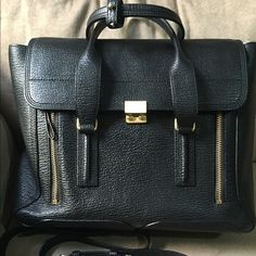 Philip Lim Large Black Pashli Black with Gold hardware in excellent condition. Only worn 2 times. Includes strap, dust bag, and stuffing. 3.1 Phillip Lim Bags Totes